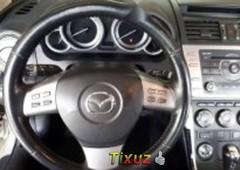 vendo un carro mazda mazda 6 2009 excelente llámama para verlo